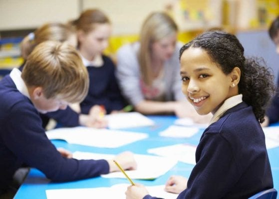 Pupil smiling in class